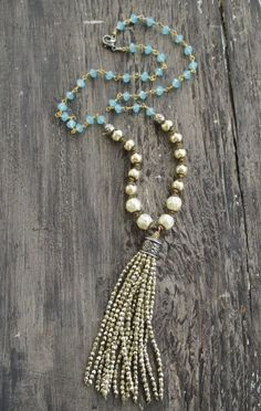 "Sparkly gold pearl tassel necklace Bohemian by slashKnots on Etsy- A vermeil wire wrapped chain of opalescent chalcedony stones along with knotted cream glass pearls holds a super lush metallic gold glass tassel. Lots of movement and shine! Artisan sterling silver and gold fill accents. Dress it up or down! Great holiday party necklace :)   Measures 24"" with a 4 1/4"" tassel drop. Sterling lobster closure."