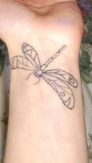 Dragonfly wrist tattoo