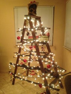 Ladder Christmas tree. Wrapped ribbon, rope, garland, and lights ...