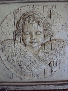 relief carved angel.