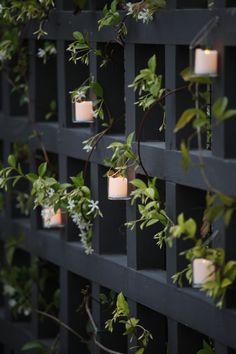 Fence detail with tea lights designed by Mark Tessier Landscape Architecture, MTLA, Inc.