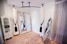 corner dressing rooms to maximize space - offers a place to store clothing and trinkets during treatment