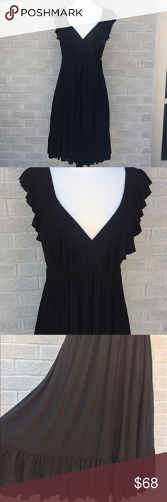 """Nicole Miller Deep V Ruffle Sleeve Tiered Dress The perfect LBD!! Nicole Miller Deep V Ruffle Sleeve Tiered Dress is ultra comfy & SO flattering! I love the back too! Throw on Sandals for a casual look or pair with heels to take this dress into evening! It is the perfect addition to any closet! A dress you will wear for years!! Size Large. Black. So soft - Rayon Spandex Blend. Approximately 37.5"""" long. In good used condition! Maybe worn twice! W38M085041917 Nicole Miller Dresses"""