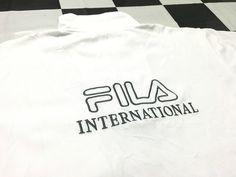 Vintage Fila half zip shirt embroidered spell out big logo Size L Fila international Good condition by AlivevintageShop on Etsy
