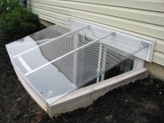 We made this egress window well cover out of 1/4 inch ...