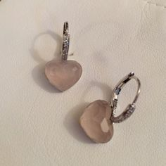 Real diamond earrings with pink stone heart Beautiful, brand new, never been worn diamond huggie earrings with pink gemstone dangling heart stone. These were given to me as a gift and I already had the same pair. Designer is called Nancy & David Fine jewels located in NJ Nancy & David Jewelry Earrings