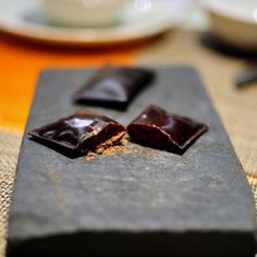 Chocolate leather packets filled with chocolate powder. Molecular gastronomy by Alex Stupak at wd-50, NY