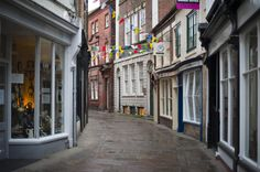 Free Stock Photo: View of the narrow cobbled street and quaint old storefronts of Grape Lane in Whitby - By freeimageslive contributor: photoeverywhere Places To Travel, Places To Visit, Living In England, Most Haunted Places, North Yorkshire, Ghost Stories, British Isles, Where To Go, Free Stock Photos