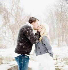 Sooooo precious. Love the white snow falling around them.