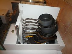 Pull-out hanging pot/pan organizer! What a nifty idea, great idea for maximizing space!