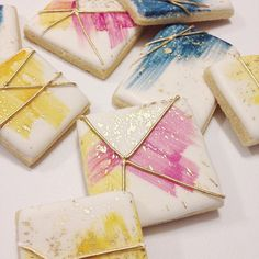 hand painted watercolor cookies with geometric lines and gold splatter. Sooo pretty... Maybe my favorites made for a photo shoot for the beautiful @5226elmevents #cookieart #cookies #watercolor #gold #CookieDecorating #CookieIdeas #ModernCookies