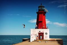 """""""Adventure Calls""""    I had a great adventure today with a dear friend. Our road trip took us to Marinette, WI for burritos and Menominee, MI to photograph Lake Michigan and one of its many light houses. Some kids were having a good time in the sun and water and were more than willing to do a bunch of jumps and flips off of this lighthouse for our cameras. Our adventures concluded in back in Bellevue, WI at Fonferek Glen, shooting and hiking in the amazing gorge and nature paths."""