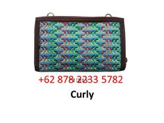 Spesification   Outside - Real Suede - Embroidery Application - Double Zipper   Size: 23 x 14 x 3 cm   Inside - Dinier Material - 2 partitions for cellphone - 1 partition fot tablet 7' - 20 slots for cards - 1 zippered partition - 2 partitions for money   Back Side - Plat Accesory  Sling Length: 140 cm.   Price: Rp. 250.000