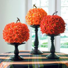 Add texture, color, and charm to your table with our delightful Petal Pumpkins. Faux flowers are hand-applied to a gourd-shaped base, and each is finished with a realistic twisted stem. Feminine and festive, they make sense in seasonal d from Labor Day through Thanksgiving. The colors harmonize perfectly when placed together. Pumpkin-shaped display completely enveloped in faux flowers They add autumnal color all season long Handmade with care...