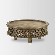 "This Carved Wood Coffee Table would be perfect in a ""Global Glam"" decor scheme. (WestElm.com)"