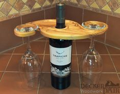 Carved wood wine glass holder with small snack tray that rests on wine bottle bottle crafts wood Wine Bottle Wine Glass Holder Wine Bottle Glass Holder, Wood Wine Holder, Bottle Display, Glass Holders, Wine Holders, Wine Craft, Wine Bottle Crafts, Diy Bottle, Wine Bottles