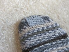 Counteracting a throw-away society Considering the time and expense of making hand-knit socks, it is well worth the effort to repair them if you eventually wear through a hole. You say you don't know how to darn a sock? Let me help with these photos and brief explanation of...