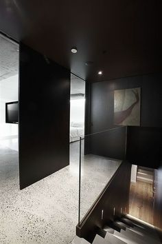 Stark contrasts between black and white, rough and smooth. Pyrmont Apartment renovation in Sydney by Bokor Architecture.