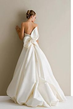 dramatic bow back wedding dress