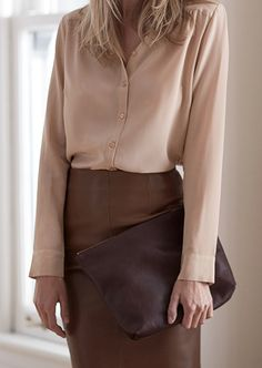Nice contrast of silk blouse with soft leather skirt/clutch. Silk & Shimmer
