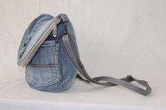 I made this unique denim bag transformer using the old blue jeans. Its a good size bag for purchases and walk. Front side made from original jeans pockets. Inside is a pocket for the phone. This bag has adjustable strap so that you can adjust it by length and make it shorter or