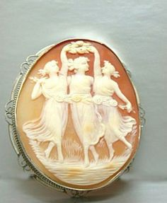 Three Graces vintage art deco set in 14k white gold Cameo and dates from the 1920's.