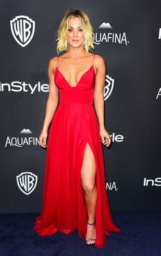 Kaley Cuoco put her cleavage on display in a plunging red gown with a full skirt. Silver heels and statement rings competed her sultry look. See more Golden Globes afterparty looks here!
