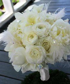 This #bridalbouquet looks like it's straight out of the Great Gatsby!  #thefloralcottageflorist #bridalbouquets #peonies #whitepeony #ranunculus #featherbouquet #louisianaweddings #batonrougeweddings #thatlacommunity #louisianagirl