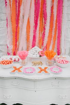 Pink and Orange Dessert Table. Loving these vibrant colors!