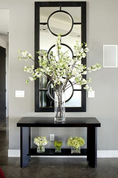 Entryway Table Decor Inspiration But WHITE- Outstanding Arrangement of Simple Stems in the Tall Glass Vase…The Small, insignificant ones underneath aren't very imaginative…Anything, or Nothing would have made a better statement to me… Foyer Decorating, Decorating Your Home, Decorating Ideas, Interior Decorating, Cheap Home Decor, Diy Home Decor, Decoration Entree, Decoration Home, Beautiful Decoration