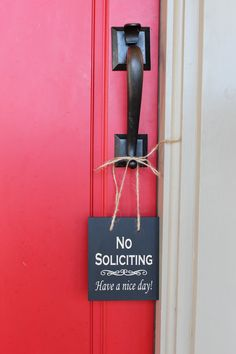 No Soliciting Have a nice day wood sign. $13.95, via Etsy.