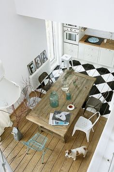 Love the change in flooring to signify kitchen space moving into dining room
