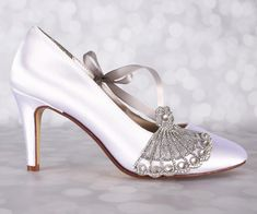 These pretty white wedding shoes are just the right amount of sparkle for your wedding day. Custom designed for each bride, these heels measure 2 3/4 (measured as shown here: http://www.customweddingshoe.com/about-ellie-wren/heel-height-measurement/) and are shown here in white,