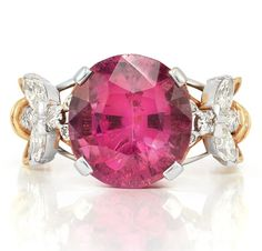 Platinum, Gold, Pink Tourmaline and Diamond 'Bee' Ring, Tiffany & Co, Schlumberger   18 kt., centering one round pink tourmaline approximately 8.75 cts., flanked by two stylized bees set with 4 marquise-shaped, 2 round and 12 single-cut diamonds, signed Tiffany, Schlumberger, approximately 9.3 dwt.