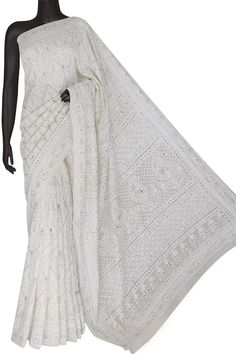Ada Hand Embroidered White Pure Georgette Lucknowi Chikankari Saree/Blouse With Muqaish Work- A595826 include an embroidered blouse, the blouse is worked up with Chikan embroidery and the sleeves include floral motifs #Ada #Adachikan #chikankari #saree #puregeorgette #handcrafted #handembroidered #premium