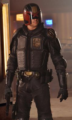 Karl Urban as Judge Dredd in Dredd. Seriously...this is an awesome movie.