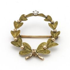 I would wear the hell out of this. Gold laurel wreath pin with seed pearl