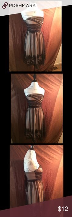 Lightweight, strapless dress. Worn once. Elegant but very comfortable strapless dress. Form-fitting and lightweight. Excellent condition. Was either never worn or worn one time. Size medium (runs true to size) Mystic Dresses Strapless
