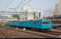 Commuter train EMU of 103 series of JR West is entering Kyoto station, coming from the Nara line.