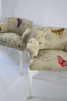 """Antique children's chairs, covered with """"Butterflies"""" fabric by Timorous Beasties."""
