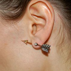 Circa 1930, a pair of late Art Deco arrow earrings in 14k rose gold with seed pearls.