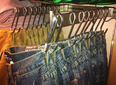 "Use shower curtain ""S"" hooks (to hang jeans (save space) they are big enough to fit around a closet rod"