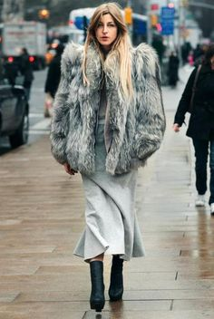 Burrrrr. Loving the length of the skirt with those boots. #fur #style