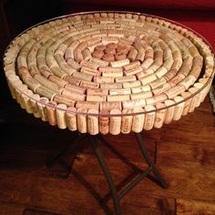 "With the help of many volunteers who sampled the wine, I finally finished my cork table!  The corks in the middle are champagne corks.  Of course, I had no problem getting volunteers for this ""DIY Home Project."""