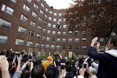A crowd watches as a piano falls from the roof of Baker House dormitory at Massachusetts Institute of Technology in Cambridge, Mass., Thursday, April 26, 2012. The annual event which began in 1972 is staged to celebrate the last day students can drop classes without having them appear on their college transcript. (AP Photo/Michael Dwyer)