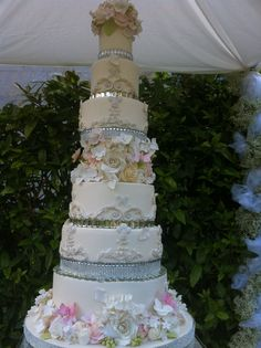 8 tier bling cake decorated with sugar flowers and butterflies!