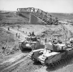 Churchill tanks of Army Tank Brigade cross the River Reno close to a destroyed railway bridge near Bastia, Italy, 18 April Wooldridge (Sgt) Ww2 Pictures, Military Pictures, Ww2 Photos, Churchill, British Army, British Tanks, History Online, Ww2 Tanks, World Of Tanks