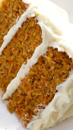 The BEST Carrot Cake Recipe ~ It's moist, perfectly-spiced, made with fresh carrots and a heavenly cream cheese frosting.