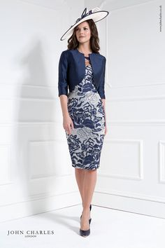 Short dress with sweetheart neck and sequin detail over the body. Over the dress is a contrasting lace overlay into a high neck and elbow length sleeves. The matching bolero jacket is collarless and scoops to the waist which is very flattering.