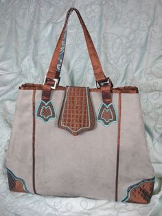 ORDERED...Designer Handbags Nancy Zieman 1  - really want this book, CD and apparently the trace & design pattern set.  I can't quite figure out all I need for this.